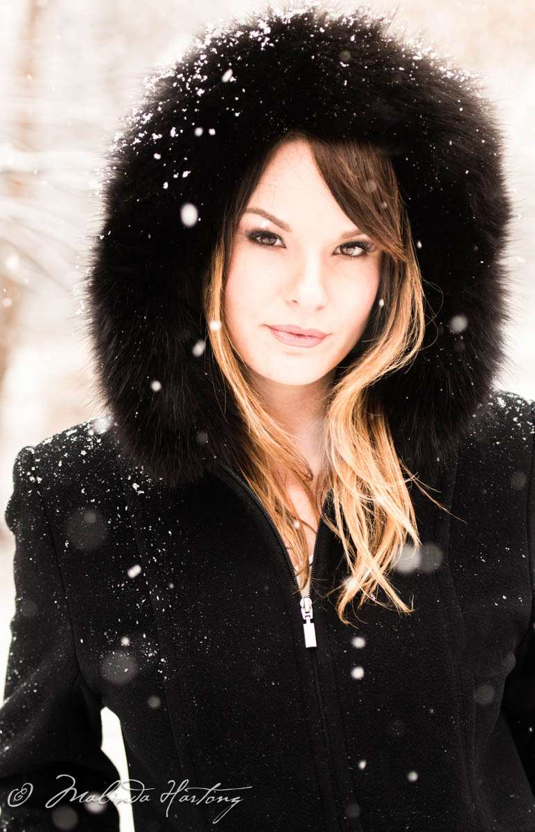 portrait on location of a girl in snow