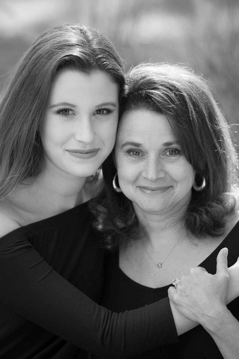 mother and daughter close in black and white