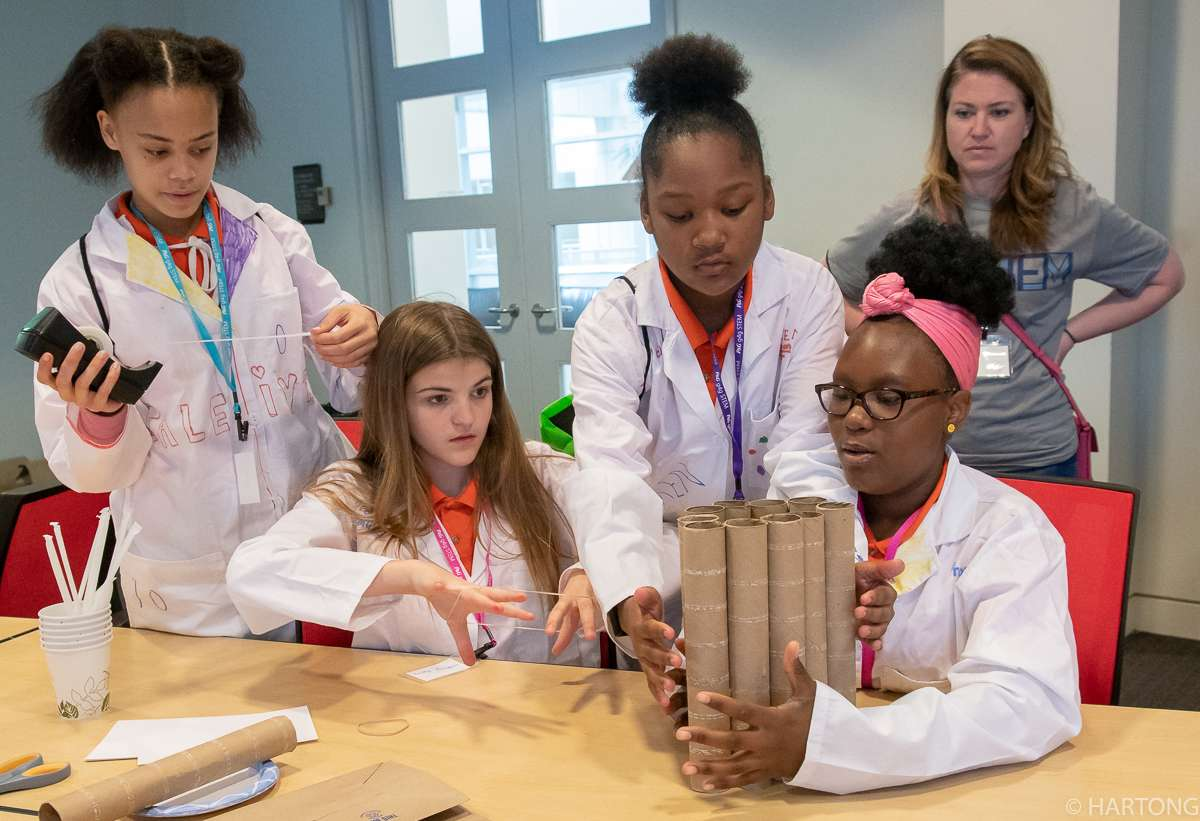 girls learn science and math during STEM event